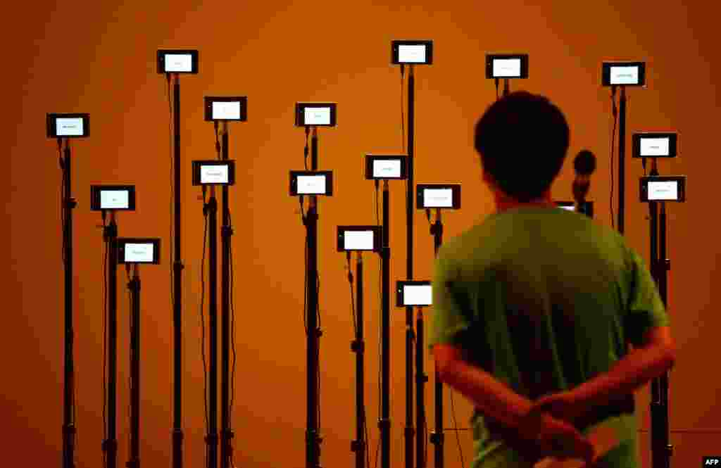 A man visits an exhibition at the China National Art Museum in Beijing.
