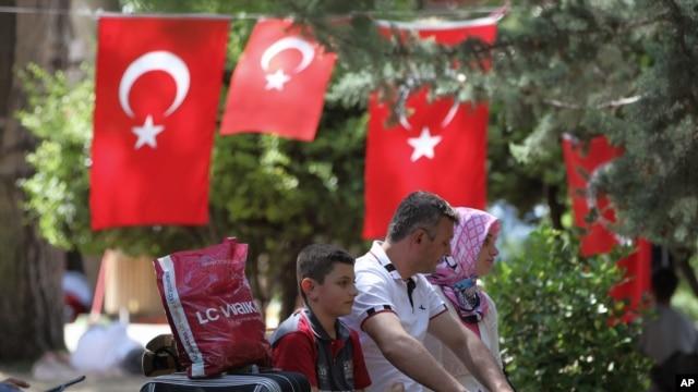 People rest in Kugulu Park in Ankara, Turkey, June 24, 2013.