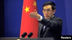 China's Foreign Ministry spokesman Liu Weimin gestures to a journalist during a news conference in Beijing (File).