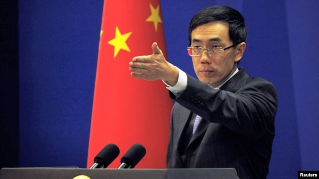 China's Foreign Ministry spokesman Liu Weimin gestures to a journalist during a news conference in Beijing (file photo).