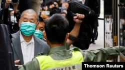 FILE PHOTO: Media mogul Jimmy Lai, founder of Apple Daily, leaves the Court of Final Appeal by prison van in Hong Kong