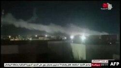 이라크-시리아 접경 친이란민병대 시설에서 미군 공습으로 연기가 나는 사진을 28일 시리아 TV가 공개했다.