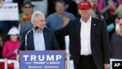 FILE - Then-Republican presidential candidate Donald Trump (R) stands next to Senator Jeff Sessions during a rally in Madison, Alabama, Feb. 28, 2016. Sharing the senator's views on illegal immigration, Trump tapped Sessions for attorney general.