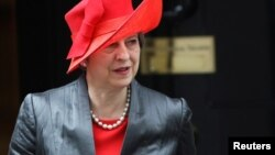Britain's Prime Minister Theresa May leaves 10 Downing Street in London, March 12, 2018.