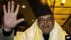 Chairman of Communist party of Nepal (United Marxist -Leninist) Jhal Nath Khanal waves after being elected as Nepal's Prime Minister in Katmandu, Nepal. Nepal's parliament finally elected Khanal as the new prime minister in its 17th attempt since the last