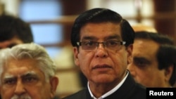 Pakistan's Prime Minister Raja Pervez Ashraf speaks to the media at a military hospital, where he visited Malala Yousufzai, in Rawalpindi, October 12, 2012.