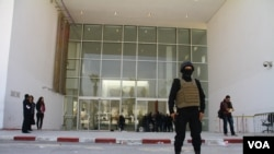 FILE - Guards secure the Bardo Museum in Tunis, hours after gunmen stormed it in March 2015. U.S. defense and intelligence officials pinned responsibility for the attack on the Islamic State group but later came to believe that a terror facilitator from al-Qaida in the Islamic Maghreb had played some role. (M. Krit/VOA)
