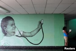 A painting by Cuban artist Maisel Lopez is seen on a wall inside a hospital in Havana, Cuba, April 20, 2017.