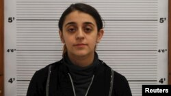 Tareena Shakil is seen after her arrest, in this undated booking picture courtesy of West Midlands Police.
