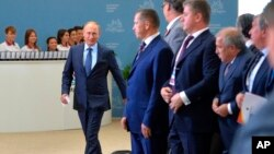 Russian President Vladimir Putin (left) arrives at the opening of the East Economic Forum in Vladivostok, Russia, Sept. 4, 2015.