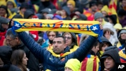 A pro-Catalan supporter holds a banner during a demonstration near the EU quarter in Brussels on Thursday, Dec. 7, 2017.
