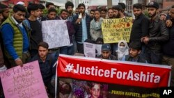 Students and others participate in a protest against the rape and murder of Asifa, an 8 year-old girl who was grazing her family's ponies on a chilly January day in the forests of the Himalayan foothills when she was kidnapped and her mutilated body found in the woods a week later, in Srinagar, India, April 11, 2018.
