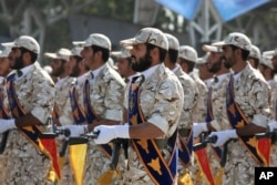 FILE - Members of Iran's Islamic Revolutionary Guard Corps march just outside Tehran during an armed forces parade, Sept. 22, 2011.