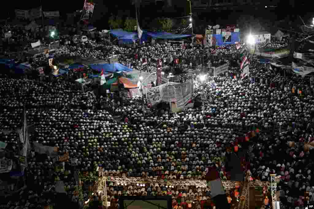 Supporters of Egypt's ousted President Mohamed Morsi pray at Nasr City, July 28, 2013.