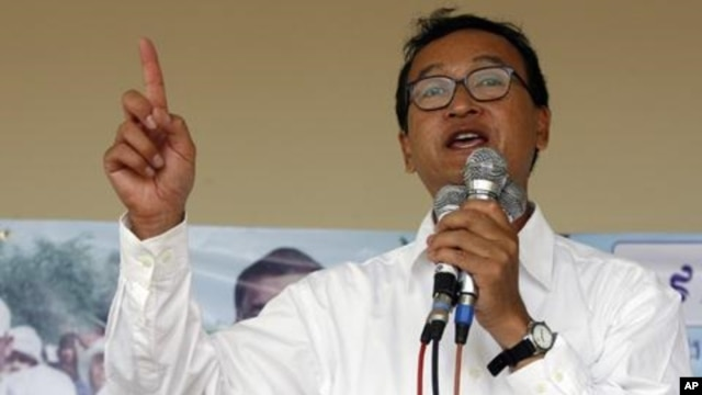 Sam Rainsy, leader of Cambodia's opposition Sam Rainsy Party, speaks during a campaign rally in Kandal province in 2008.