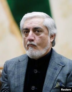 Afghanistan's presidential candidate Abdullah Abdullah arrives for a news conference after the preliminary presidential election results in Kabul, Afghanistan, Dec. 22, 2019.