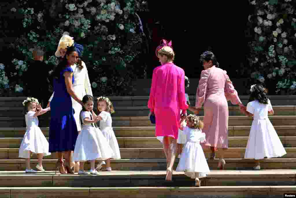 Britain's Catherine, Duchess of Cambridge and Meghan Markle's friend, Canadian fashion stylist Jessica Mulroney holds bridesmaids hands as they arrive for the wedding ceremony of Britain's Prince Harry, Duke of Sussex and U.S. actress Meghan Markle at St George's Chapel, Windsor Castle in Windsor, Britain, May 19, 2018.