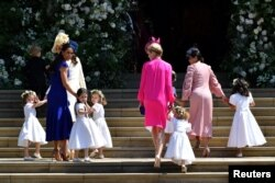 Britain's Catherine, Duchess of Cambridge and Meghan Markle's friend, Canadian fashion stylist Jessica Mulroney holds bridesmaids hands as they arrive for the wedding ceremony of Britain's Prince Harry, Duke of Sussex and U.S. actress Meghan Markle.