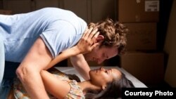 """Bradley Cooper and Zoe Saldana in a scene from """"The Words"""" (Photo courtesy CBS Films)"""