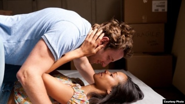 "Bradley Cooper and Zoe Saldana in a scene from ""The Words"" (Photo courtesy CBS Films)"