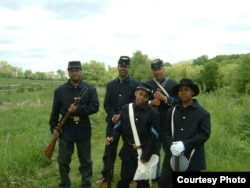 Marlowe's students pose with Civil War re-enactors (Robert Houston, Thurston Jones and Cicero Green) on a break from filming 'Back in Time With Cheltenham.' Green's great-great-grandfather was a soldier at Camp William Penn.(J.Marlowe, 2005)