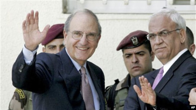 Special Envoy for Middle East Peace George Mitchell, left, and Chief Palestinian negotiator Saeb Erekat, right, wave before a meeting with Palestinian President Mahmoud Abbas, in the West Bank city of Ramallah, 30 Sep 2010