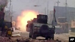 This image made from Associated Press video shows a tank during clashes in Fallujah, June 26, 2016.
