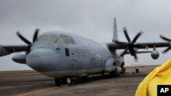 Un U.S. C-130, similaire à celui dans lequel a été retrouvée la dépouille du jeune clandestin (AP)