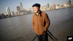 Chinese-born U.S. scientist Hu Zhicheng stands at the waterfront promenade along the Huangpu River in Shanghai, China, January 2013.