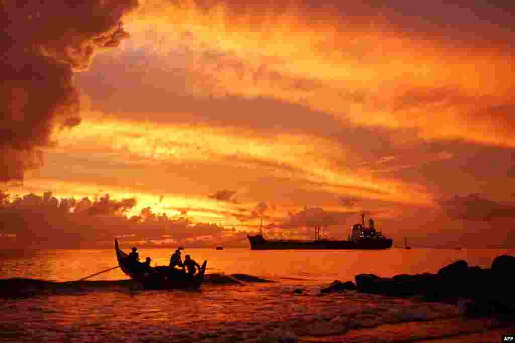 A fishing boat heads out to sea in the early morning in Lhokseumawe, Aceh, Indonesia.