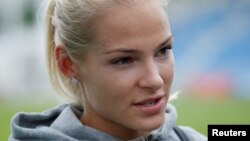Darya Klishina talks to the media after competing the women's long jump in Zhukovsky, Russia, June 6, 2016.