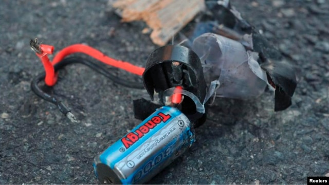 Boston Marathon bomb scene pictures taken by investigators show the remains of an explosive device, April 16, 2013.