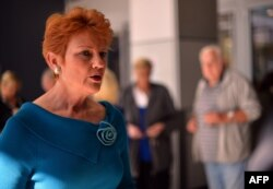 FILE - One Nation Party founder and Senate candidate Pauline Hanson (L) is pictured as she campaigns at a shopping arcade in the suburbs of Sydney on August 14, 2013.
