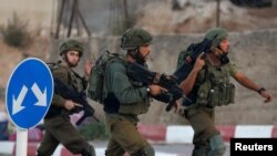 İsrail hərbi qüvvələrinin əsgərləri İordan çayının Qərb sahilində