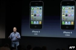 Apple's Phil Schiller talks about the iPhone 4S world phone during an announcement at Apple headquarters in Cupertino, Calif., Tuesday, Oct. 4, 2011. (AP Photo/Paul Sakuma)