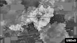 This video grab shows a coalition airstrike destroying Islamic State militant group's finance distribution center near Mosul, Iraq, Jan. 11, 2016. The Pentagon has released several videos in recent weeks that U.S. officials say, show coalition aircraft bombing IS cash depots in Mosul, Iraq and nearby city of Ninevah.