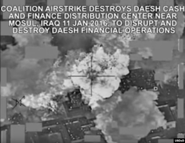 This video grab shows a coalition airstrike destroying Islamic State militant group's finance distribution center near Mosul, Iraq, Jan. 11, 2016.