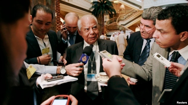 Egypt's then-Finance Minister Hazem el-Beblawi addressing media in Abu Dhabi, Sept. 7, 2011.