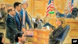 在華盛頓聯邦法院,特朗普的前國家安全顧問邁克爾·弗林與律師聆聽法官宣判。(2018年12月18日)