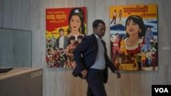 A man walked past movie posters at the 2019 Cambodia International Film Festival in Phnom Penh, Cambodia, March 12, 2019. (Khan Sokummono/VOA Khmer)