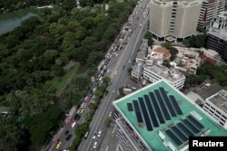 Solar panels are pictured on the roof of a building in Bangkok, Thailand, Aug. 9, 2017.