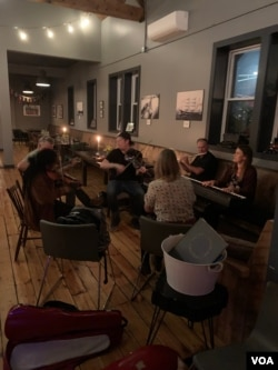 Popular PEI musical group Vishten plays with family as an afterparty to the Route 11 music festival in PEI, which has largely been spared by the pandemic. (Jay Heisler/VOA)