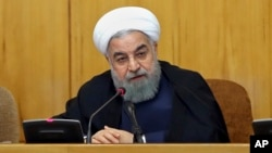 In this photo released by official website of the office of the Iranian presidency, President Hassan Rouhani speaks during a cabinet meeting in Tehran, Iran, July 19, 2017. The U.S. House of Representatives voted overwhelmingly July 25, 2017, in favor of imposing new sanctions on Iran.