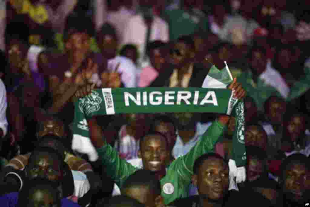 Nigeria soccer fans celebrate after Nigeria's Sunday Mba scored a goal against Burkina Faso during their African Cup of Nations final match in Lagos, Nigeria, Sunday, Feb. 10, 2013. Nigeria erupted in celebrations after their Super Eagles won the Africa