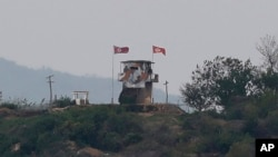 "FILE - In this May 3, 2020, file photo, a North Korean flag flutters in the wind at a military guard post in Paju, at the border with North Korea. North Korea on Friday, May 8, slammed South Korea for staging what it called ""reckless"" military…"