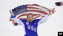 Jocelyne Lamoureux-Davidson of the United States celebrates after winning the women's gold medal hockey game at the 2018 Winter Olympics in Gangneung, South Korea, Feb. 22, 2018.