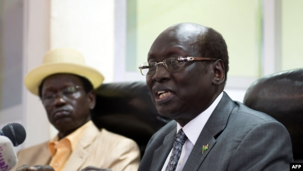 South Sudan's Foreign Minister Barnaba Marial Benjamin speaks during a press conference with Interior minister Aleu Ayienyi Aleu (L), in Juba, South Sudan, April 18, 2014. The Government of South Sudan strongly condemns the attack on innocent civilians in