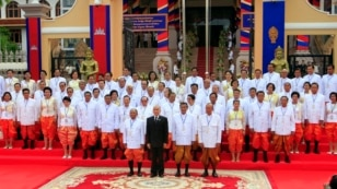 From left in front row, Cambodia's National Assembly President Heng Samrin, King Norodom Sihamoni, Prime Minister Hun Sen and Minister of Royal Palace Kong Samol pose with the nation's lawmakers during a photo session in front of the National Assembly in Phnom Penh, Cambodia, Monday, Sept. 23, 2013. The Cambodian opposition boycotted the opening of parliament Monday over alleged widespread cheating in the July elections, putting the country's political crisis at a critical juncture. (AP Photo/Heng Sinith)