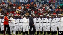 Kenyan President Uhuru Kenyatta, centre, inspects a guard of honor parade mounted by the Kenyan Navy, during the 53rd Jamhuri Day Celebrations (Independence Day) at Nyayo Stadium in Nairobi, Dec. 12, 2016.