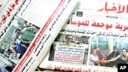 Egyptian broadsheet newspapers present on their front page pictures of Ilan Grapel, as Egypt's state security prosecution began questioning the Israeli man suspected of spying for the Mossad intelligence agency, state TV reported, June 13, 2011